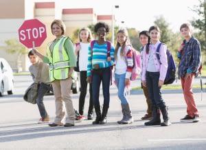 Children with school crossing guard